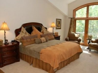 "The master suite is your private retreat! It has a king sized bed, custom linens, an entertainment armoire complete with a 32"" LCD High-Definition TV, DVR and Roku, and a comfortable lounge area...not to mention a magnificant view of the mountains!"