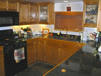 Kitchen with gas stove, microwave, dishwasher, coffeemaker, washer and dryer