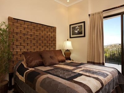 Guest bedroom with double bed and marina view, private balcony