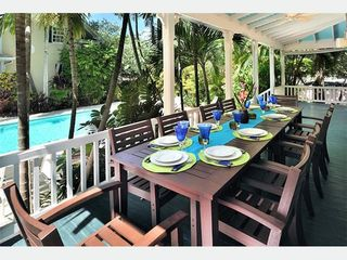 Key West house photo - Outdoor dining for the whole (extended) family. Table can be split in two.