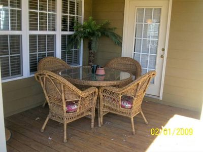 relax on covered back deck overlooking golf course