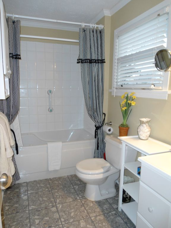 Ensuite bathroom to ground floor bedroom with jacuzzi tub, in-tub shower