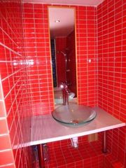 1st Arrondissement Louvre apartment photo - stylish bathroom but you have to appreciate the red colour ...
