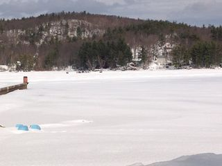 Gilmanton cottage photo - ice fishing and snowmobiling on the frozen lake!