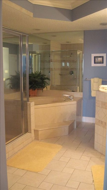 Master bath with spa tub; separate shower and double sink