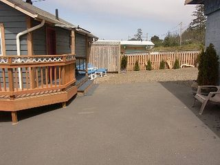 Depoe Bay townhome photo - 67x100 ft. private parking area with 6 ft security fence.