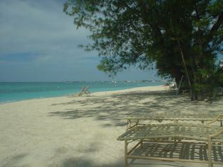 Grand Cayman condo photo - Harbour Height's private beach has shade and sun
