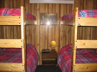 Bunkhouse has 3 br's with bunkbeds, Lodge has 1 br with bunkbeds