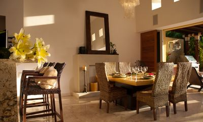 The stylish dining room comfortable serves 6-8.
