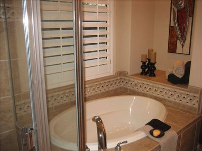 Ensuite bathroom with shower and large tub