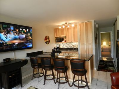 JACKPOT! You just found the best unit. Custom remodel and a HDTV on Steroids!