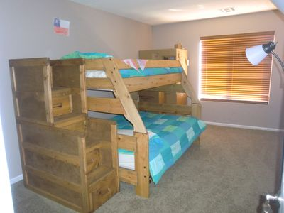 Kids room with twin over double bunk & twin rundle