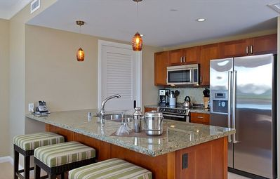 Breakfast bar in kitchen with all top of the line Bosch appliances.