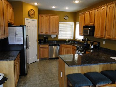 Gourmet kitchen with stainless appliances and granite countertops