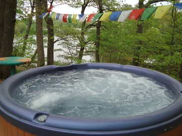 relax in the outdoor hot tub overlooking the creek