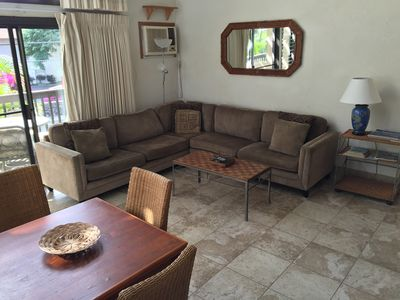 Large, open living room featuring a new couch and new tile floor. KGE, C-205