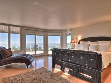 Fall in love with this luxurious master bedroom - floor2ceiling glass windows