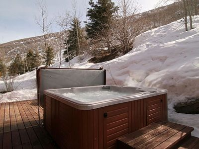 Private hot tub with a mountain view