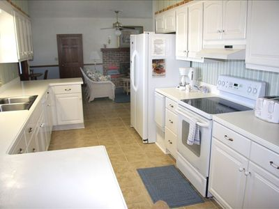 Kitchen with all appliances, extra ice maker and  utensils.