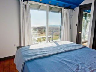 Chilmark cottage photo - Master Bedroom Enjoys Water Views From Bed