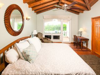 Master bedroom with private balcony and ensuite bath - Roatan villa vacation rental photo