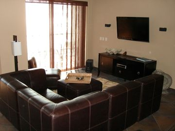 Living Room with 42' Wall Mounted TV Bose System