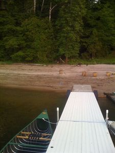 View of boat and dock and sandy beach