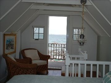 Bedroom sitting area and balcony view
