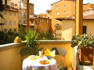 Buon giorno! Breakfast on the sunny little terrace overlooking rooftops.
