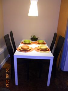 Kitchen table can accommodate two more on either end