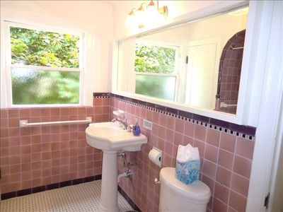 Upstairs bath with original tiles and new fixtures with large mirror