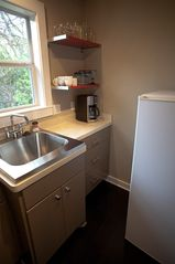 Austin studio photo - Microwave, fridge, coffee maker and toaster oven. And wine glasses!