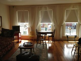 Belfast apartment photo - Lovely old pine floors enhance the space. A table has been added.