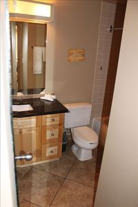 Brand new tiled bathroom, granite counters, light wood