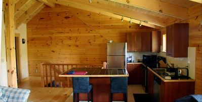 KITCHEN, CHERRY RAILING, LAUNDRY AT LEFT. MOST OF THE WOOD IS FROM OUR FOREST!