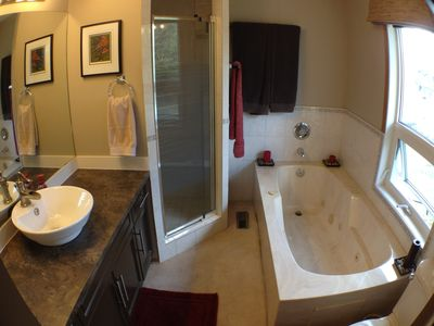 Full ensuite with shower and jetted tub