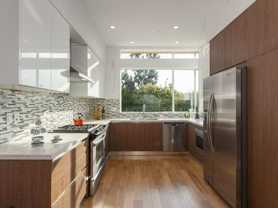Spacious kitchen that opens to living/dining.