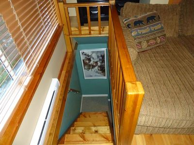 Stairs down to second bedroom