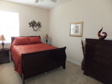 Queen bedroom with chest of drawers and nightstands & large closet