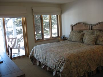 Two bedrooms on 1st floor include full baths, tvs, and porch access. King/Twin