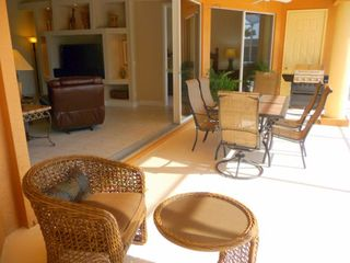 Cape Coral house photo - Lanai dining and sitting area is perfect for poolside Bar-BQing