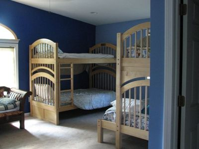 spacious bunkroom with 2 twin beds, 2 sets of bunkbeds and full hideaway bed