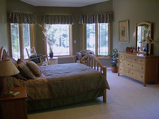 Master Bedroom with sitting area. - Pentwater house vacation rental photo