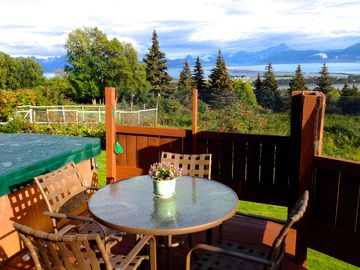 Homer house rental - Outdoor hot tub and dining area with great views of the Spit and Kachemak Bay.