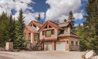 Ski in ski out custom home at edge of national forest yet in breck town limits!