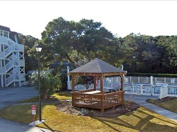 Condo faces outdoor pool w/ picnic area and gazebo