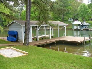 Lake Gaston house photo - Boat house has lots of chairs and loungers. Paddle boat.