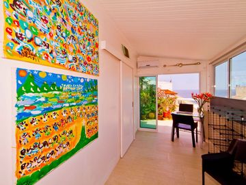 Office with ocean view/ocean breezes and local Brazilian art
