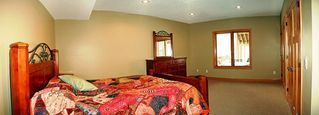 Prior Lake house photo - Huge bedroom has trundle bed and queen bed - SPACIOUS! TV!