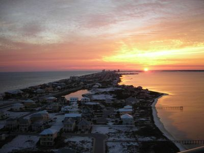 The sunset is seen from the balcony   between  the Gulf and Sound